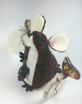 Butterfly catching Mouse